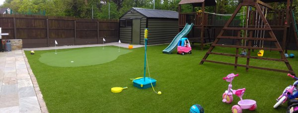 Artificial grass lawn with putting green
